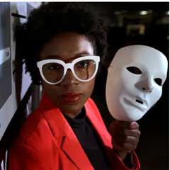 Massachusetts Institute of Technology facial recognition researcher Joy Buolamwini on Feb. 13, 2019, at the school, in Cambridge, Mass. Her research has uncovered racial and gender bias in facial analysis tools sold by companies such as Amazon that have a hard time recognizing certain faces, especially darker-skinned women. Buolamwini holds a white mask she had to use so that software could detect her face. (Photo: Steven Senne, AP)