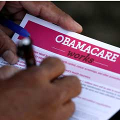 Person filling out Obamacare form