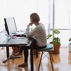 Woman working at home; credit Gallup