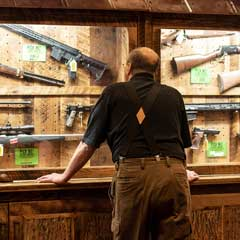 A case of firearms at the National Rifle Association's annual meeting in Indianapolis in 2019. With a newly expanded conservative majority, the Supreme Court's calculus on Second Amendment appeals may have changed. Credit...Lisa Marie Pane/Associated Press