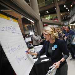 "Precinct secretary Ari Fleisig at a caucus precinct site in Des Moines, Iowa, on Monday. The Iowa Democratic Party said that the data collected ""was sound"" despite the smartphone app malfunction. Michael Zamora/NPR"