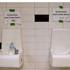 "Drinking fountains are marked ""Do Not Drink Until Further Notice"" at Flint Northwestern High School in Flint, Mich., in May 2016. After 18 months of insisting that water drawn from the Flint River was safe to drink, officials admitted it was not. Carolyn Kaster/AP"