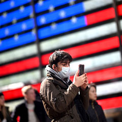 A man uses his cell phone in New York's Times Square on March 5, 2020.Johannes Eisele / AFP via Getty Images file