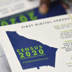 In August, a worker gets ready to pass out instructions in how to fill out the 2020 census during a town hall meeting hosted by U.S. Rep. Hank Johnson, D-Georgia, at a senior center in Lithonia. CREDIT JOHN AMIS / ASSOCIATED PRESS