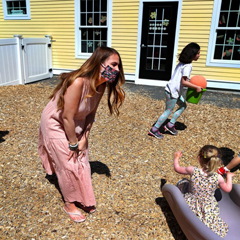 A teacher keeps an eye on children playing at Magical Beginnings Learning Academy in Middleton, Massachusetts, May 2020. Credit: Getty/The Boston Globe/John Tlumacki