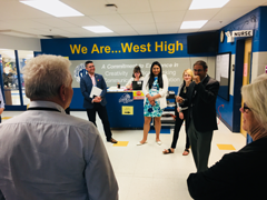 Connecticut legislative staffer Steven Hernandez, NCSL staff Marilyn Villalobos and Chloe Gunder, Principal Richard Dichard, and commission member Alice Peisch of Massachusetts, at West High School.