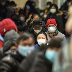 People wait at Wuhan Red Cross Hospital in Wuhan, China, on Jan. 24. HECTOR RETAMAL/AFP VIA GETTY IMAGES