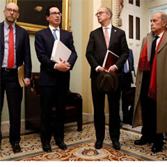 Treasury Secretary Steve Mnuchin, second from left, speaks with members of the media as he departs a meeting with Senate Republicans on an economic lifeline for Americans affected by the... moreTreasury Secretary Steve Mnuchin, second from left, speaks with members of the media as he departs a meeting with Senate Republicans on an economic lifeline for Americans affected by the coronavirus outbreak on Capitol Hill in Washington, March 16, 2020. Standing with Mnuchin is White House chief economic adviser Larry Kudlow, right. Patrick Semansky/AP