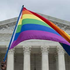 A gay pride flag outside the Supreme Court. The court said Monday it will decide whether existing civil rights laws ban discrimination on the basis of sexual orientation.Molly Riley/AFP-Getty Images file
