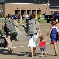Staff Sgt. John Carlin walks off the flightline with his family May 13, 2001, at Little Rock Air Force Base, Ark. Sergeant Carlin is assigned to the 61st Airlift Squadron. (U.S. Air Force photo/Staff Sgt. Chris Willis) May 13, 2001.
