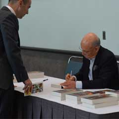 Jeremy Rifkin signs copies of his book, The Zero Marginal Cost Society, after a session at NCSL's Legislative Summit.