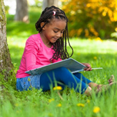 Girl studying under tree