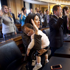 Delegate Kathy Tran (D) holds her daughter Elise during her swearing-in ceremony at the Virginia General Assembly on Wednesday morning. Tran is among the 28 women now serving in the chamber, a record high. (Timothy C. Wright for the Washington Post.)