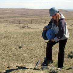 In this Sept. 14, 2004, file photo, Smith Ranch-Highland employee, April Frausto, samples water for contamination, at a monitoring well on the perimeter of the uranium mining zone 30 miles north of Douglas, Wyo. (AP Photo/Robert Black)