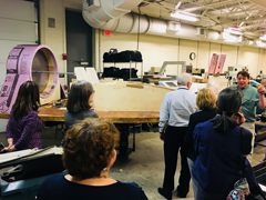 Commission members touring the Manchester School of Technology's Advanced Manufacturing Program, where students are building a hovercraft made by hand under the direction of teacher Dan Cassidy.