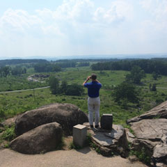 Tennessee Senate Speaker Pro Tempore Bo Watson looks out at Devils Den from the fabled hill called Little Round Top.