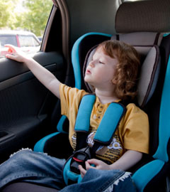 Child in a car booster seat