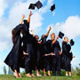 Picture of graduates throwing hats