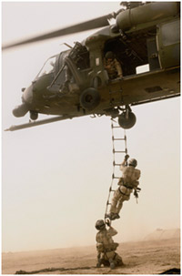 Soldiers getting off a helicopter