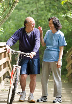 senior man and woman biking
