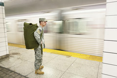 Soldier watching an arriving train