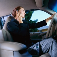 Woman driving talking on a cell phone