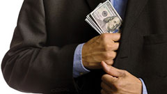 Photo of man putting money in his pocket