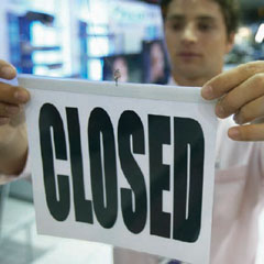 "Government worker holding ""Closed"" sign"