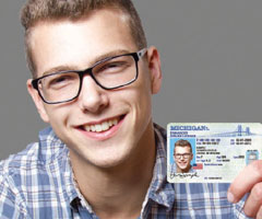 Man holding an enhanced driver's license.