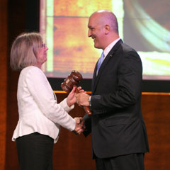 Outgoing NCSL President Terrie Norelli hands the gavel to new President Bruce Starr