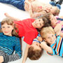 six kids laying on the floor