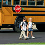 Kids walking from school bus.