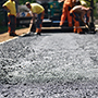 Workers working on a road.