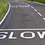 Slow sign painted on the highway.