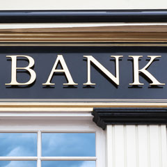 A bank sign on the outside of a building.