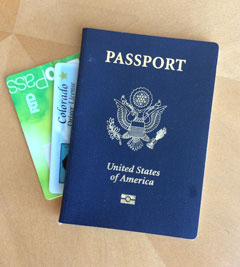 Photo of a passport, driver's license and bus pass.