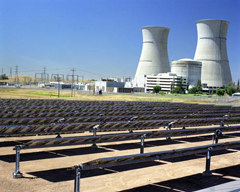 Nuclear power plant with solar panels in the foreground