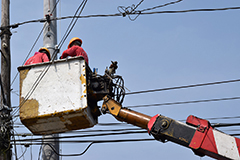 Utility workers working on power lines.