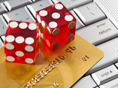 Dice, credit card and keyboard