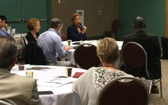 Senator Tanya Cook (NP-Neb.) speaks to colleagues at the Fellows meeting in Minneapolis.