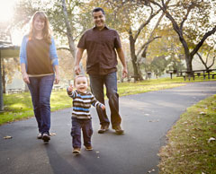 Family of three walking on path