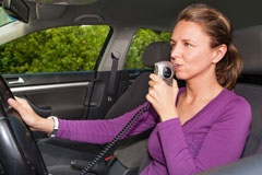 Woman in a car using an ignition interlock device