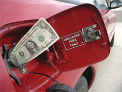 dollar into a gas tank