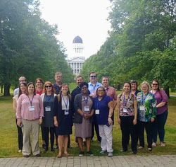 A photo of the LRL group in front of the Maine State Capitol