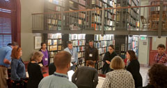 A photo of Jamie Rice of the Maine Historical Societies Brown Research Library speaking to LRL members inside the libraries main room.