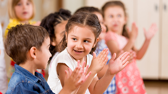 young children clapping their hands