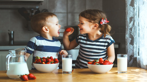 young children eating strawberries