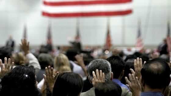 Immigrants taking citizenship oath