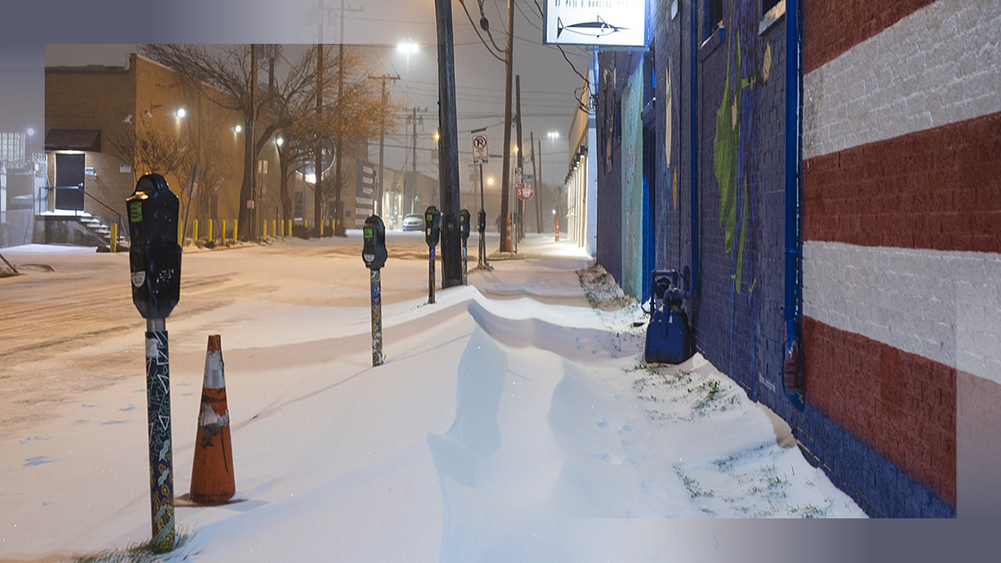 snow-covered sidewalk in the deep ellum neighborhood of dallas after winter storm of february 2021