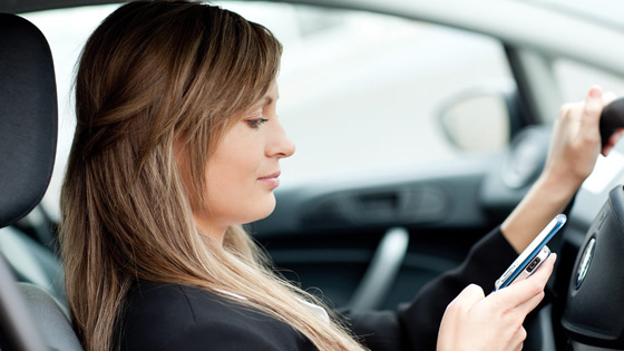 Woman texting while driving.